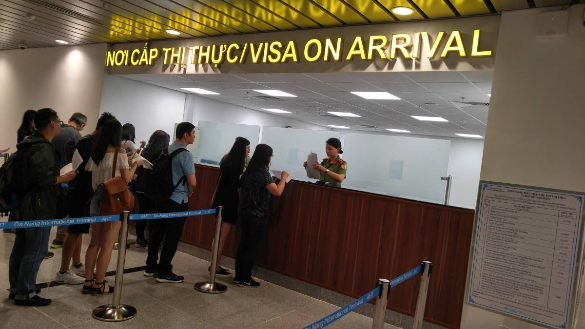 Vietnam-visa-on-arrival-office-in-Da-Nang-Intl-Airport-Vietnam Vietnam Visa Application Form on vietnam business, receiving inspection form, vietnam war 1968 tet offensive, vietnam invitation letter, vietnam itinerary, vietnam entry form, us citizenship application form, project completion form, vietnam embassy, vietnam tourism, vietnam passport,
